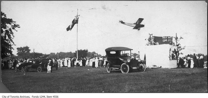 Curtis Jenny JN4 airplane doing stunts at Willowdale Flax Festival. - 1919 - photograph possibly taken at Jack Elliott's property in Willowdale.