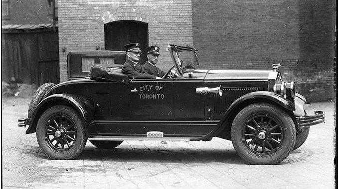 Deputy Chief Duncan McLean in City of Toronto automobile 1927-1940