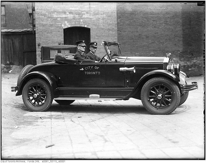 Toronto Fire Department photographs Deputy Chief Duncan McLean in City of Toronto automobile 1927-1940