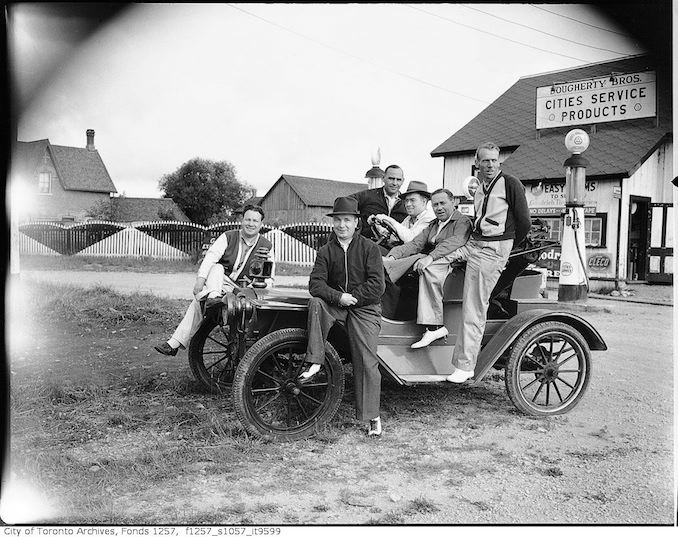 Group in old automobile, Dougherty Bros. service station, French River 194?