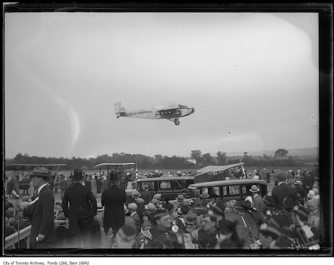 Gypsy Moth airplane in field. - 1929 - photograph probably taken at a farm in Whitby.
