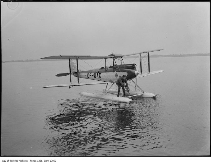 Indian Treaty flight, Captain Roy Maxwell paddling plane. - June 25, 1929