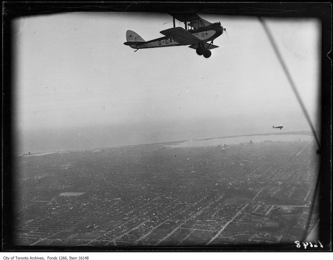 Leaside airdrome, moth plane G-CAVF in flight, one other. - April 10, 1929