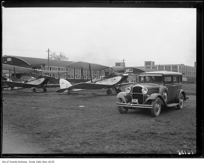 Leaside airdrome, planes and J.H. Boyd Dodge car. - April 10, 1929