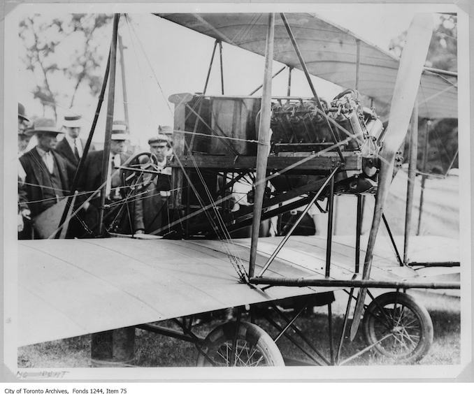 Lincoln Beachey's airplane. - 1910 - photograph of men examining an airplane. Information provided by a researcher indicates that the airplane is probably Lincoln Beachey's Curtiss-type Pusher bi-plane with 8-cylinder Curtiss V-8 engine and no forward control surfaces, and that the event is probably the Buffalo Aero Club Aviation Meet, Fort Erie, Ontario, June 20-24, 1911.