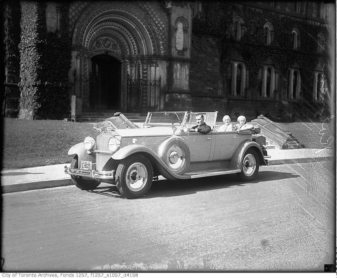Man (Robinson?) and two women in automobile in front of University College 1931