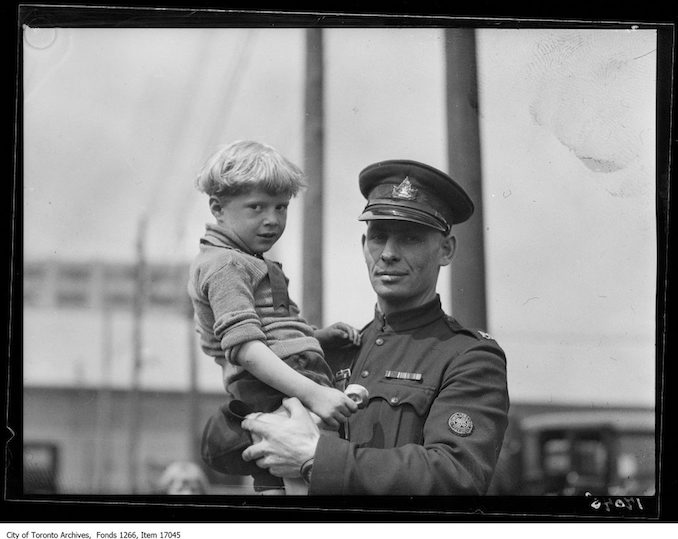 Motor League picnic to kids, patrol, Sergeant Dunn with boy. - June 24, 1929