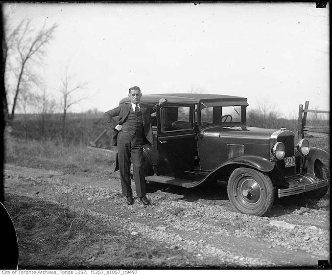Nat Turofsky next to automobile 1930