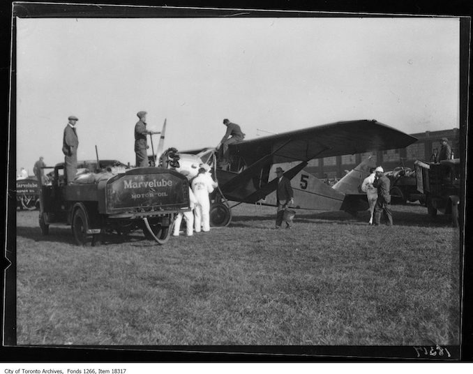 National Air Tour, refuelling plane, Imperial Oil truck. - October 5, 1929