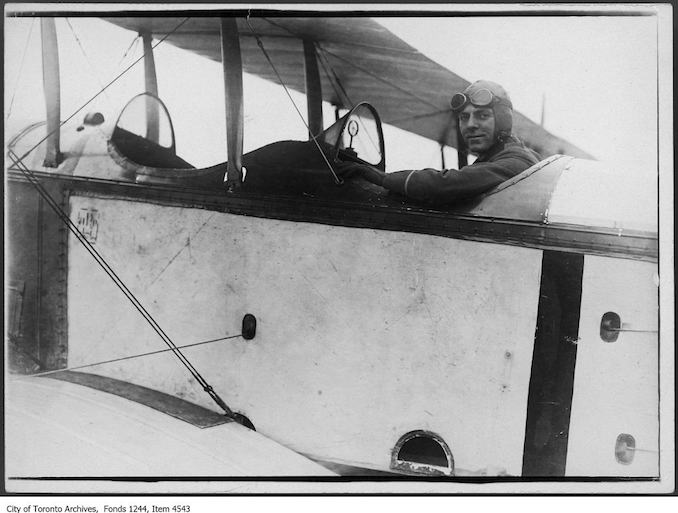 Pilot in Curtiss JN-4 airplane. - 1918