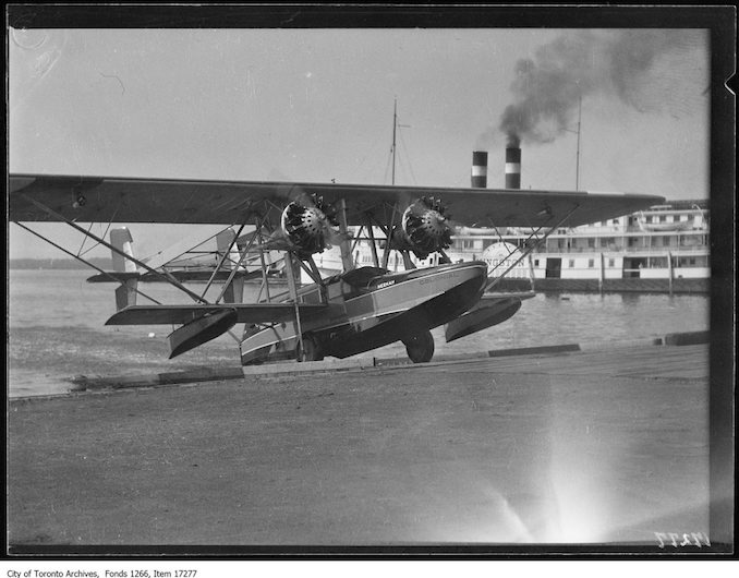 Plane christening, Neekah coming up runway. - July 15, 1929