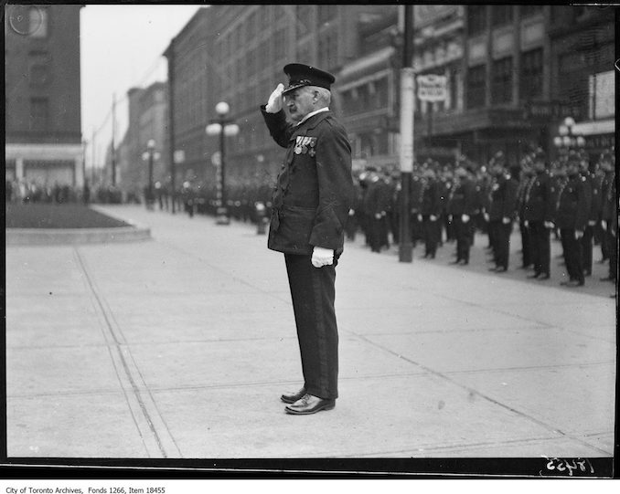 Police parade, Chief Draper at salute. - October 20, 1929