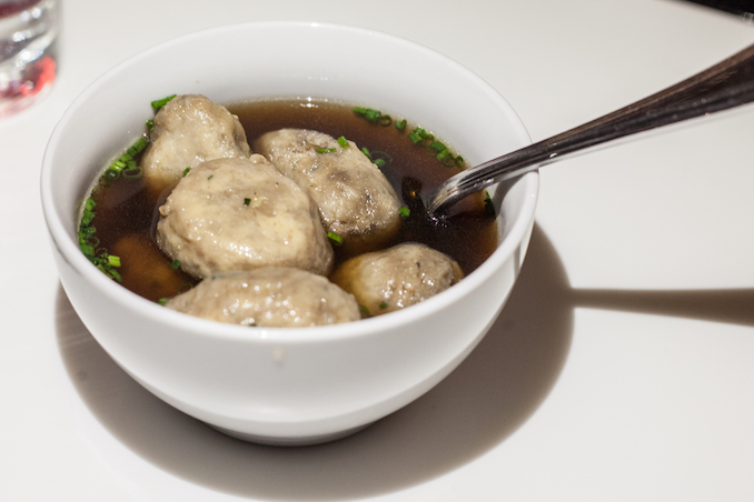 Dumplings in mushroom broth with cheese