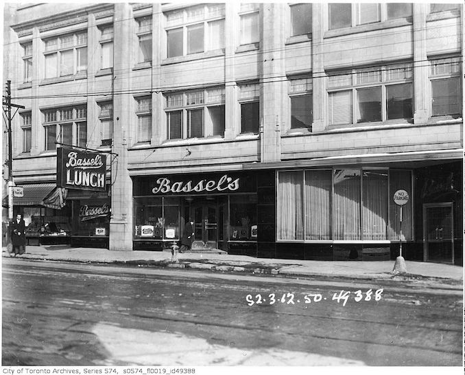 1950 - looking south-east toward 387-391 Yonge Street, at Gerrard Street, occupied by Bassel's Lunch