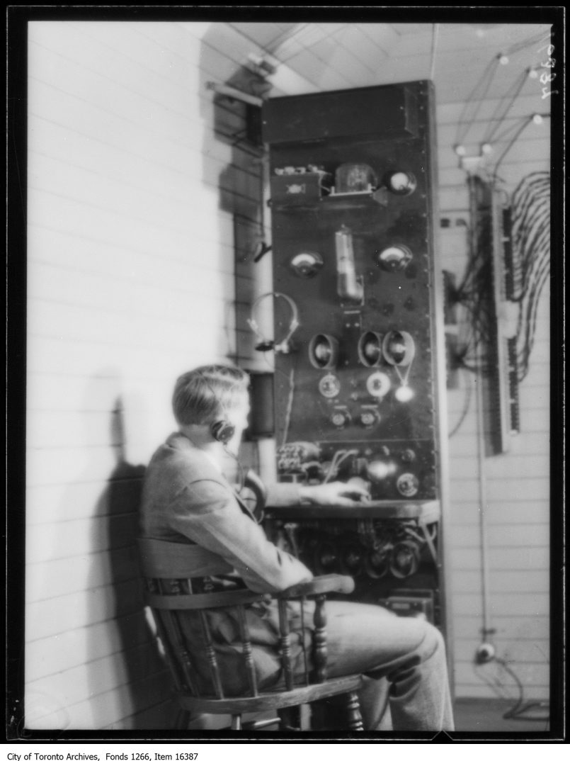 CNR train telephone, Harry Lang, assistant engineer at control panel. - May 5, 1929