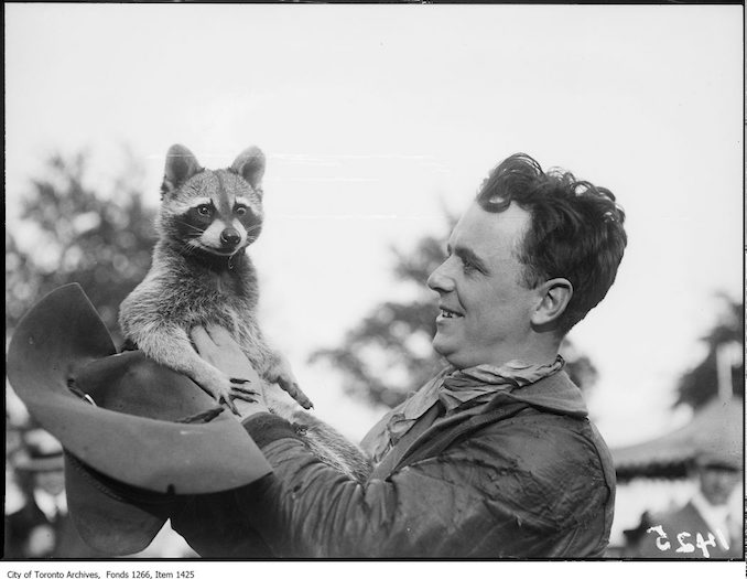 Exhibition, Tex Tressler and pet raccoon, back. - September 5, 1923