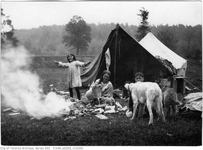 Gypsy camp showing a woman, children and dogs oct 12 1918
