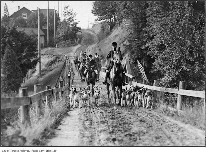 Hunters and dogs on muddy Bathurst Street north of St. Clair Avenue West. - [between 1907 and 1908]
