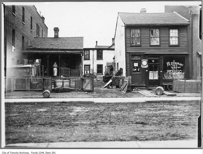 "Lettering on restaurant window is partially in Hebrew. Photo appeared in the Toronto World, December 4, 1910, ""Picturesque if not Artistic--Glimpses of 'The Ward'."" - Chicken warehouse, Agnes Street - 1910? Vintage Restaurant Photographs"
