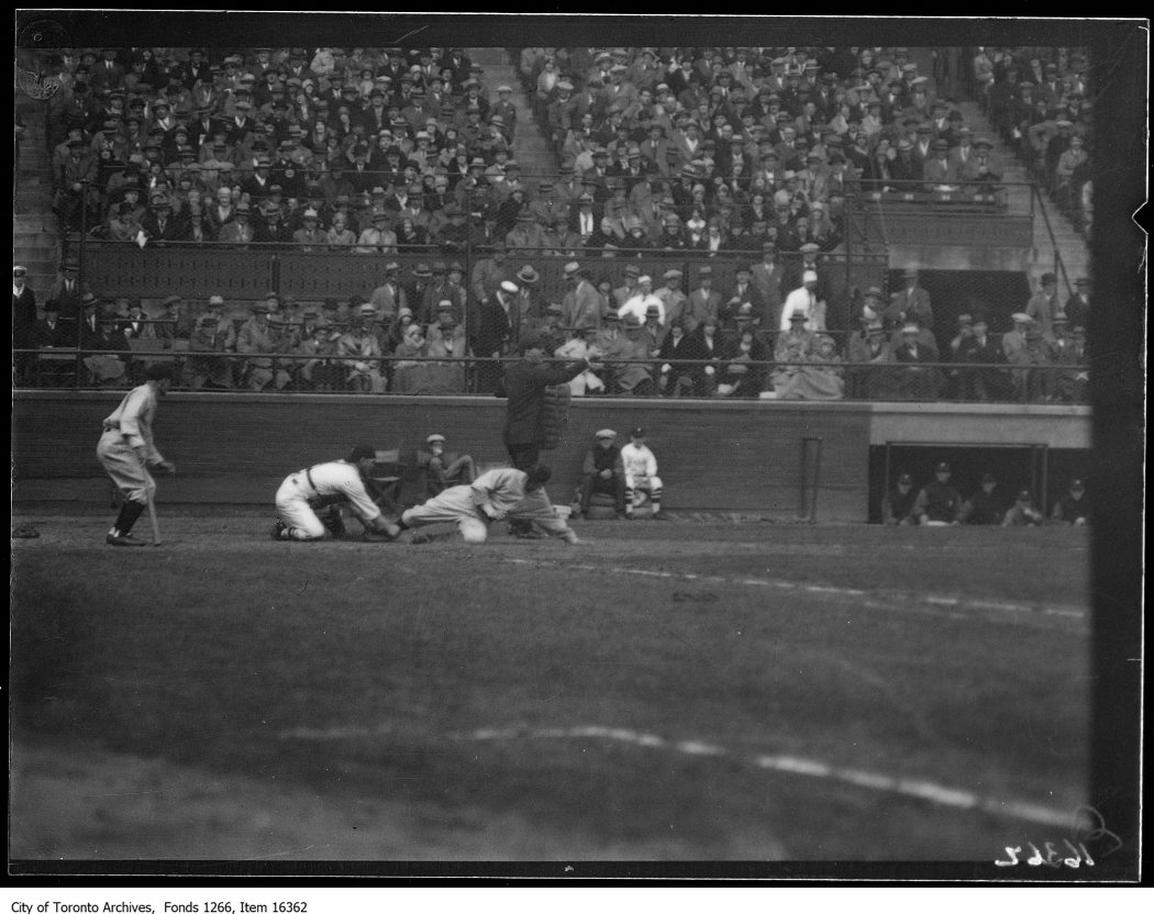 Opening ball game, Baltimore 1st run, slide at home. - May 1, 1929