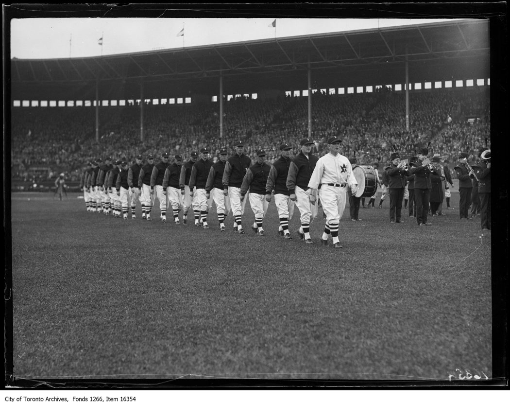 Opening ball game, Toronto team marching. - May 1, 1929