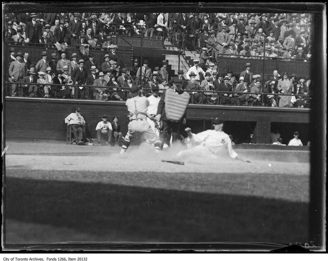 Opening ball game, slide at home plate. - May 6, 1930