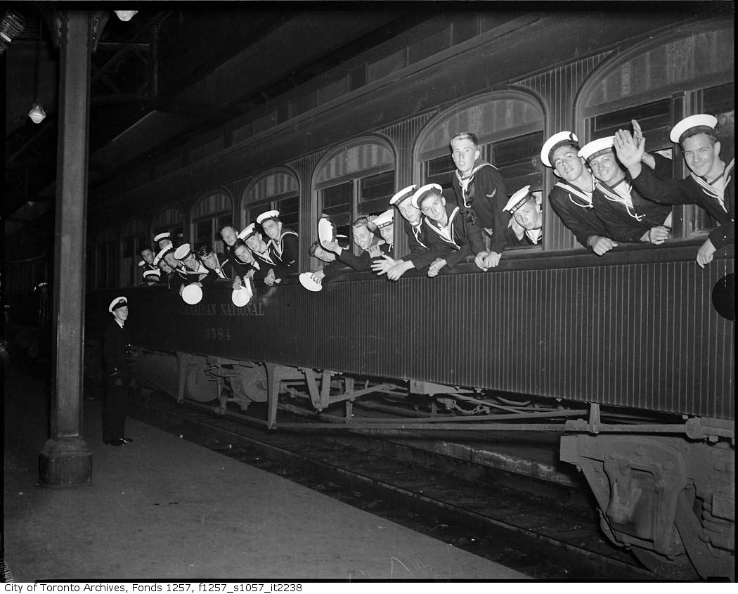 Sea Cadets on train in station - 194?