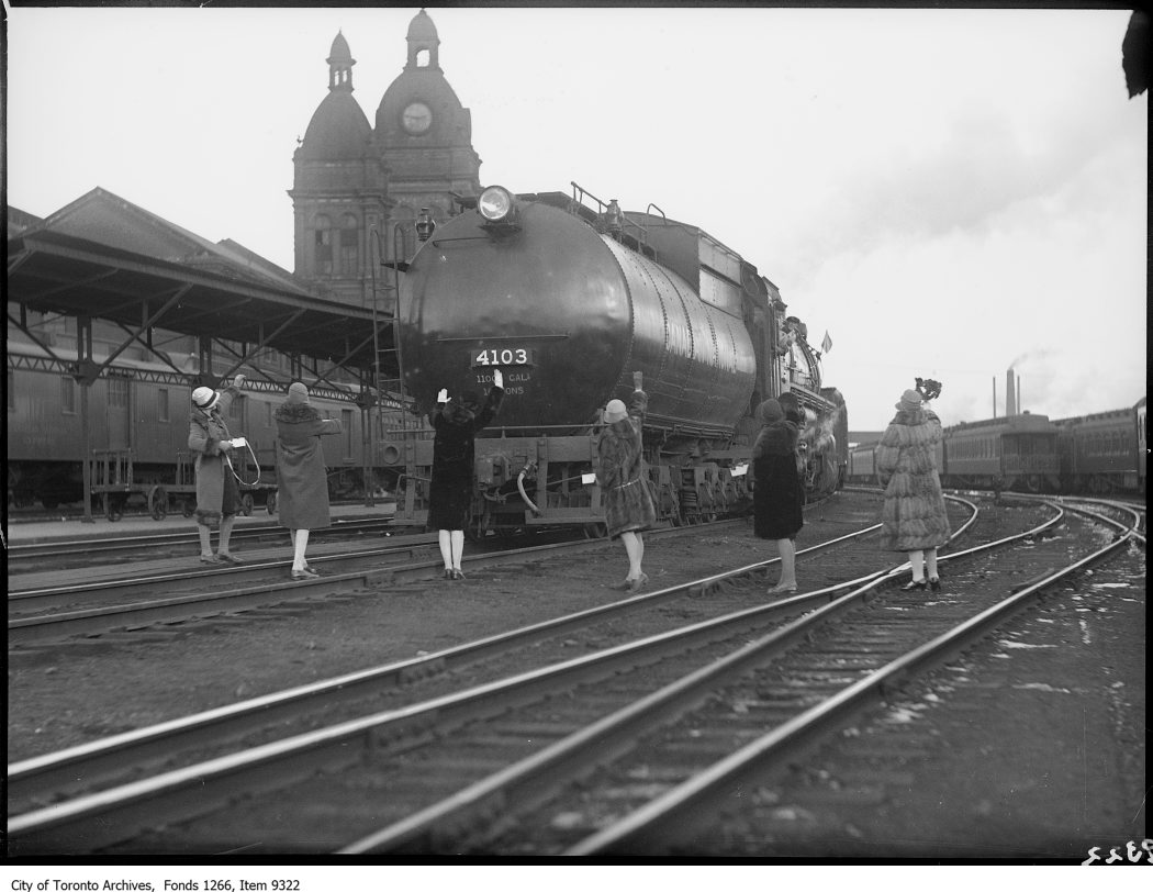 Taggers in RR yds, stopping train. - November 11, 1926