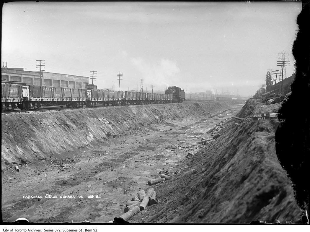 Train of cars, looking northeast (east of Dufferin). - June 8, 1911