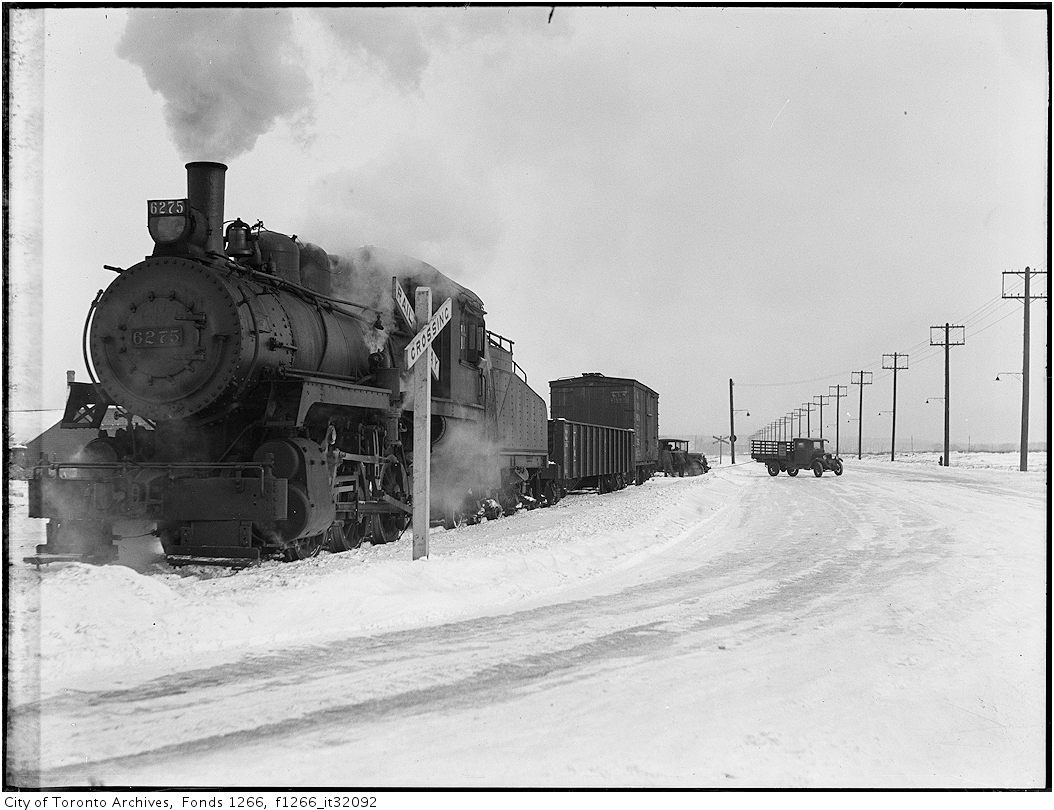 Truck stalled by freight train, Keating St - Dec 29 1933
