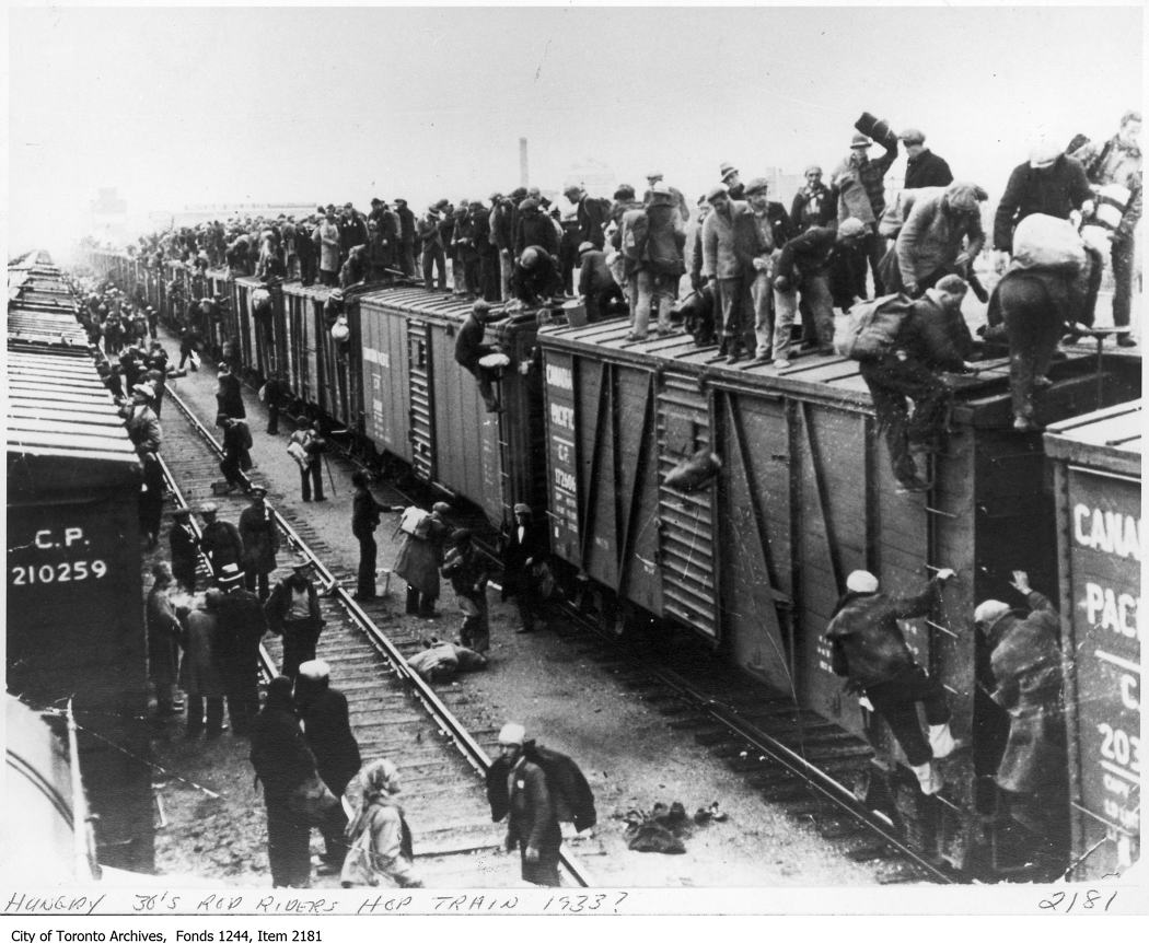 Unemployed men hop a train. - [ca. 1933]