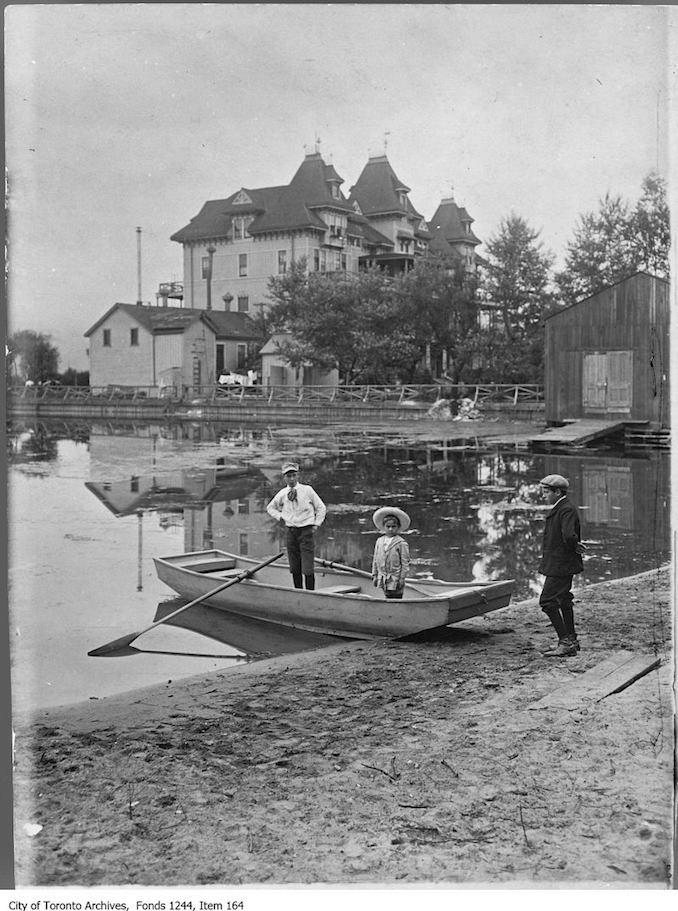 1907 - Three boys with a skiff on the beach near Hanlan's Hotel