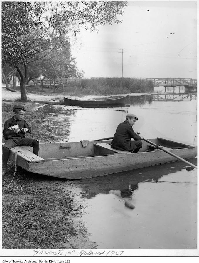 1908 - Two boys in skiff at water's edge, Toronto Island