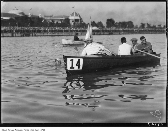 1928 - C.N.E., Men's Swim, Georges Michel swimming by boat