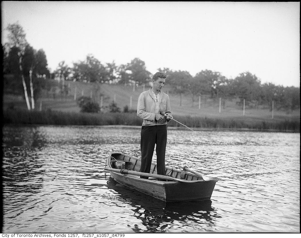 1930 - 1950 - Man fishing from boat - Vintage Fishing Photographs