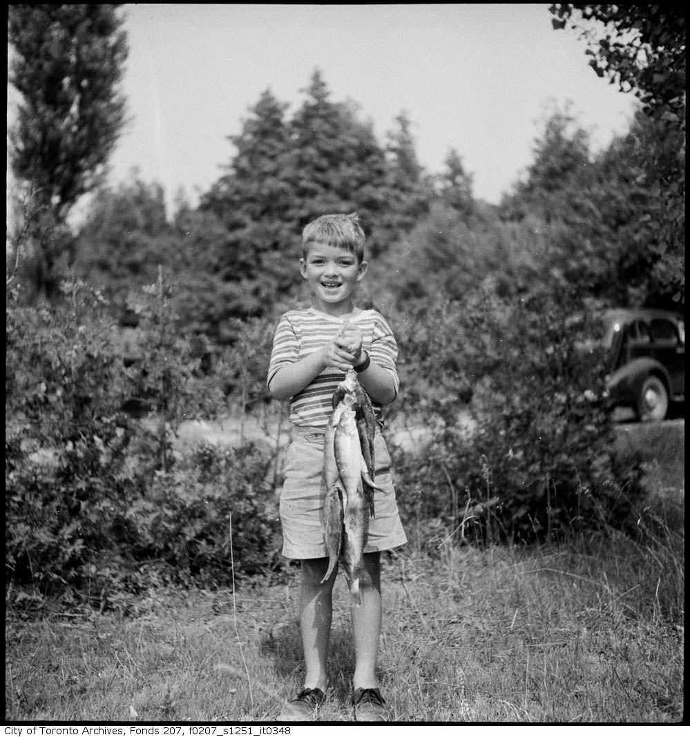 1934 - June - Boy with fishing catch - Vintage Fishing Photographs