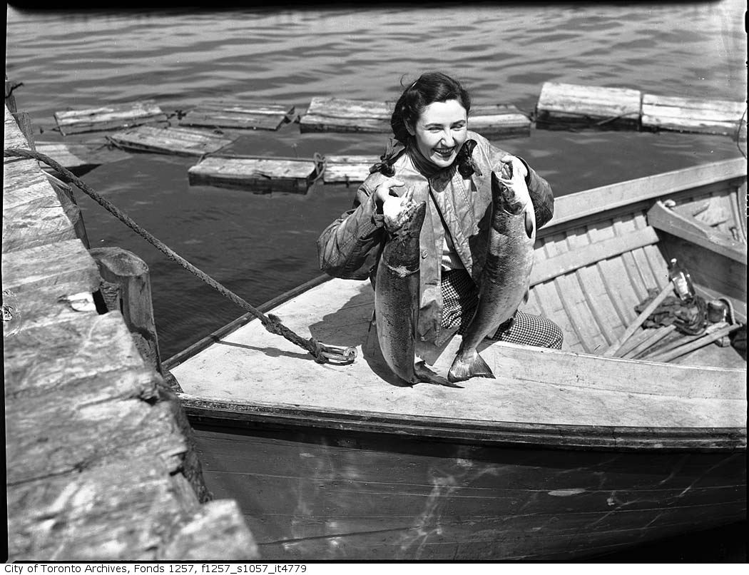 194? - Woman holding up fish - Vintage Fishing Photographs