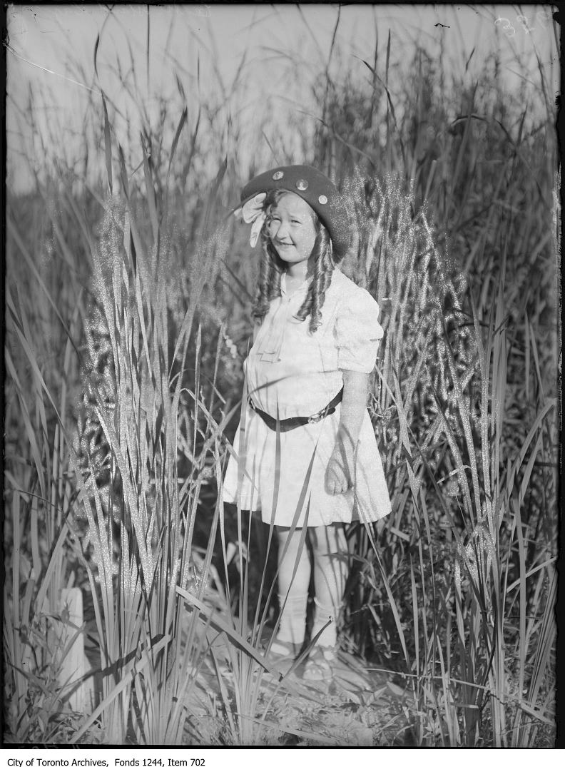 1908 - Girl surrounded by rushes at Centre Island lagoon