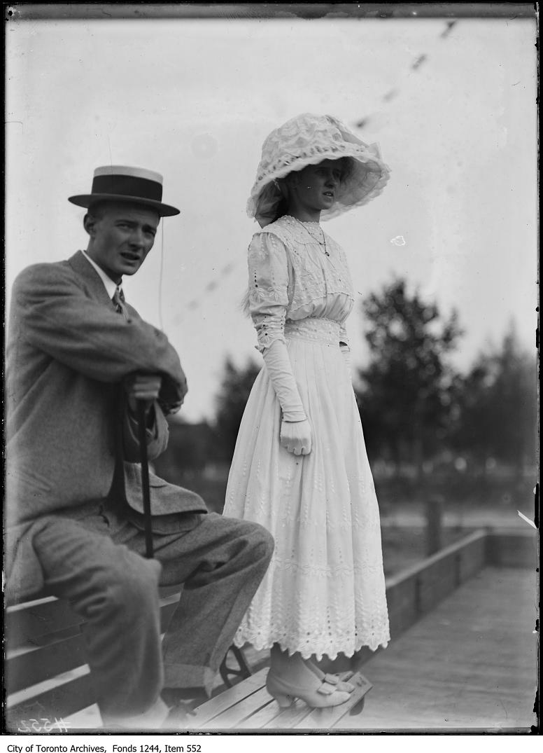 1910 - FasCouple on bench watching Centre Island regatta