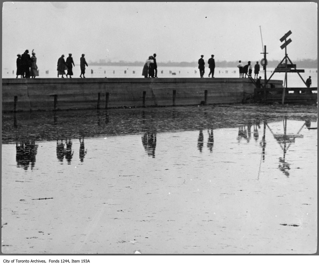 1911 - Sunday parade on Ward's Island - Poles for a new sea wall are visible in the distance.