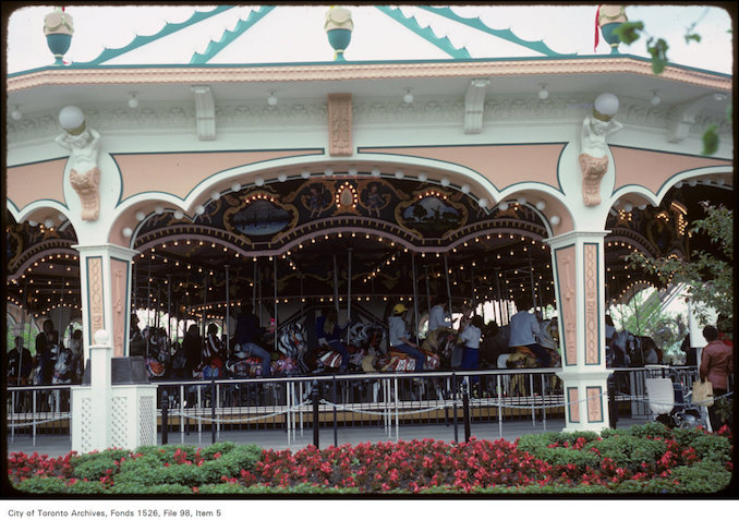 1981 - June 8 - View of carousel and surrounding flower beds at Canada's Wonderland