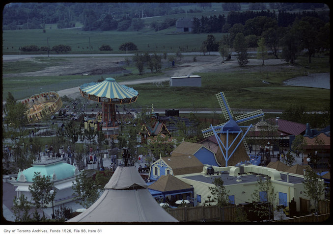 1981 - june 8 - View of flying swing ride, windmill and other rides on Canada's Wonderland grounds