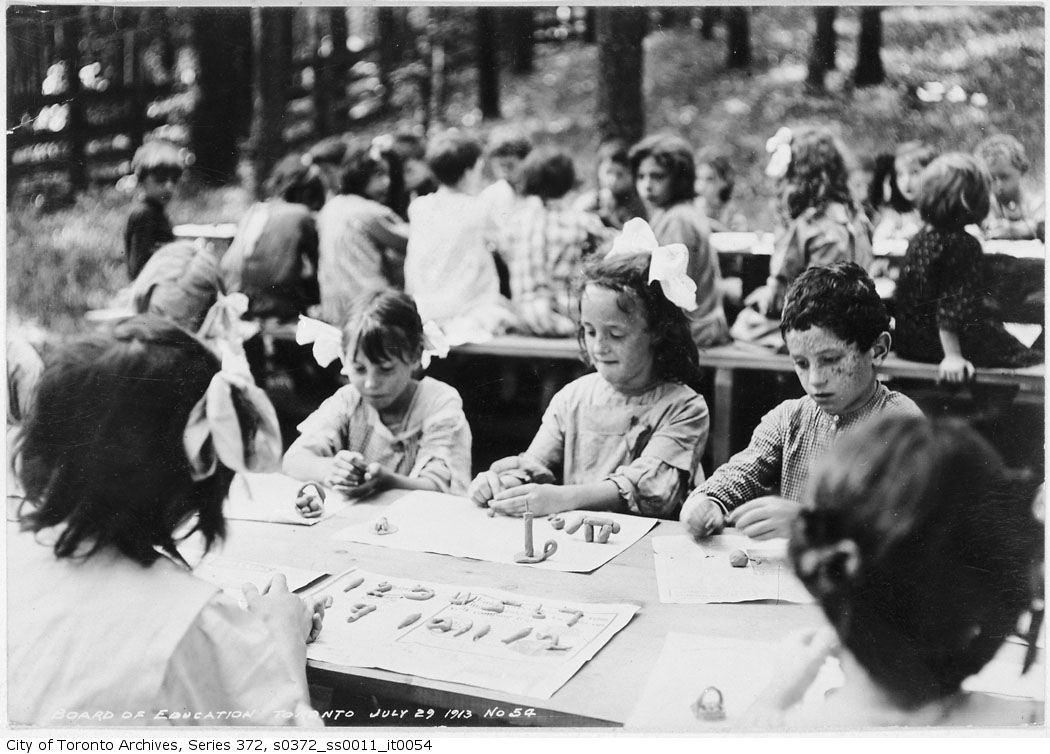 1913 - Forest School - Children playing with plasticine