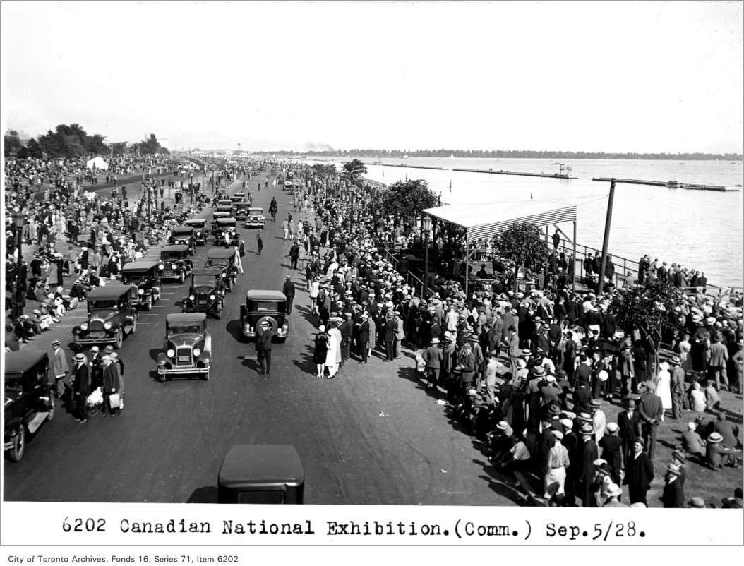 1928 - looking east on Lakeshore Blvd. south of Ontario Government Building showing crowds assembling for waterfront show at CNE