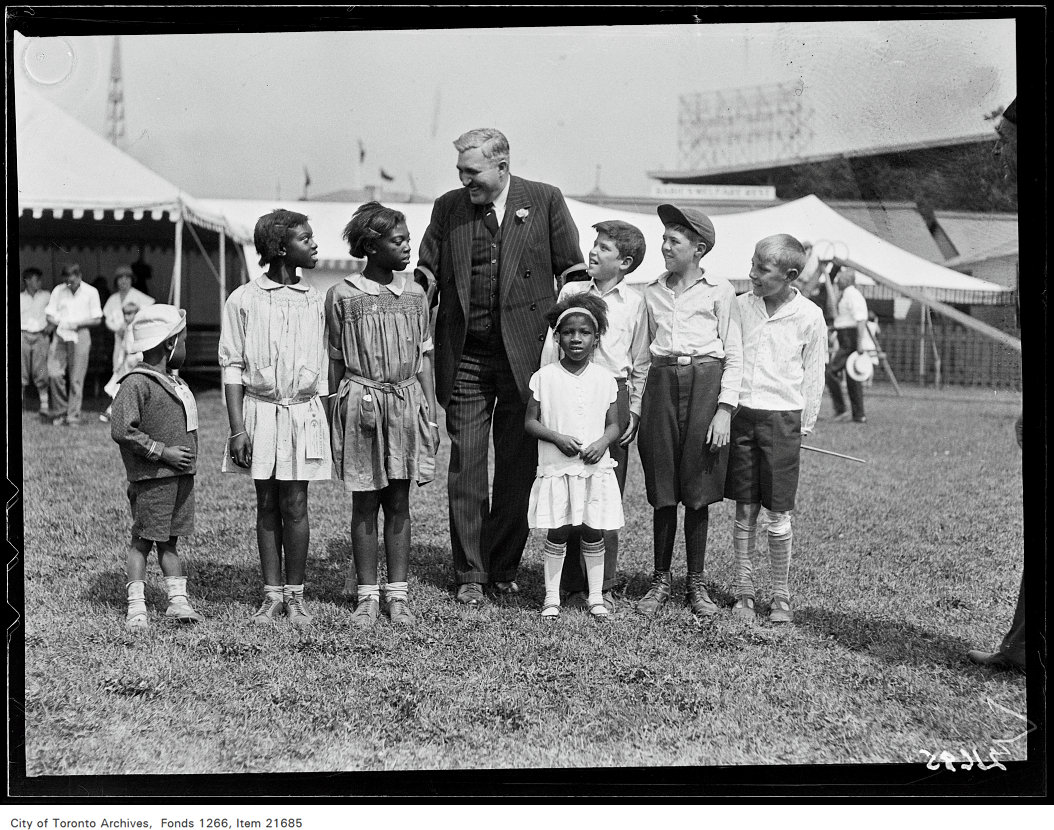 1930 - CNE, Children's Day, Jack Ramsden with kids