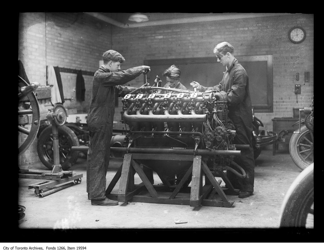 1930 - Western Technical School, boys working on aviation motor
