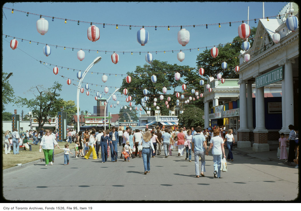 1974 - View of crowd on CNE grounds in front of Horticulture Building