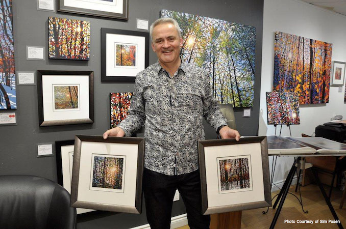 Me at Liss Gallery This is a photo of me with a number of our framed paper prints - Tim Packer