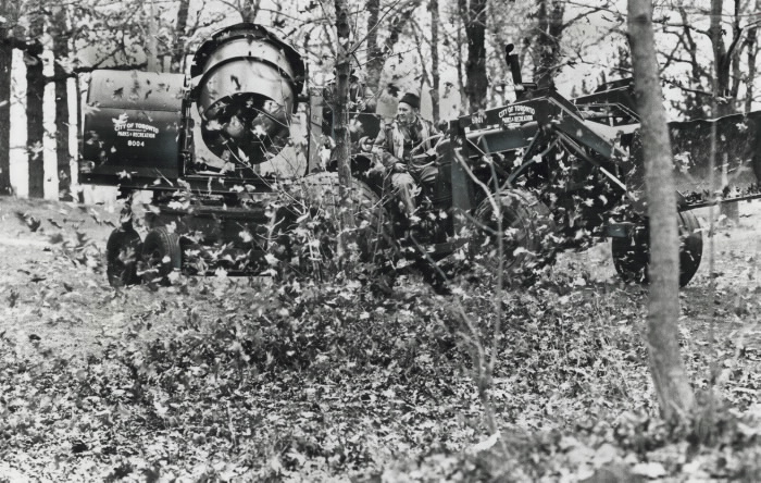 1977 - Blowing up a storm of leaves; If you ever wonder who and how they rake up leaves in High Park just follow Jim Warner and Jim Forsythe of city's parks and recreation department.
