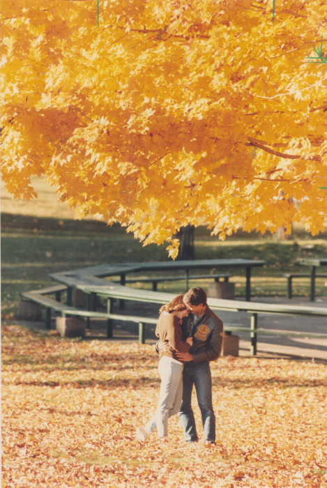 1985 - It was great while it lasted but the weatherman says our golden autumn is about to be blown away by cold winds as Averill Clarke and Jim Nikiforos linger in the glory of High Park.